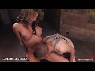 Bound bald guy with a mouth full of tranny